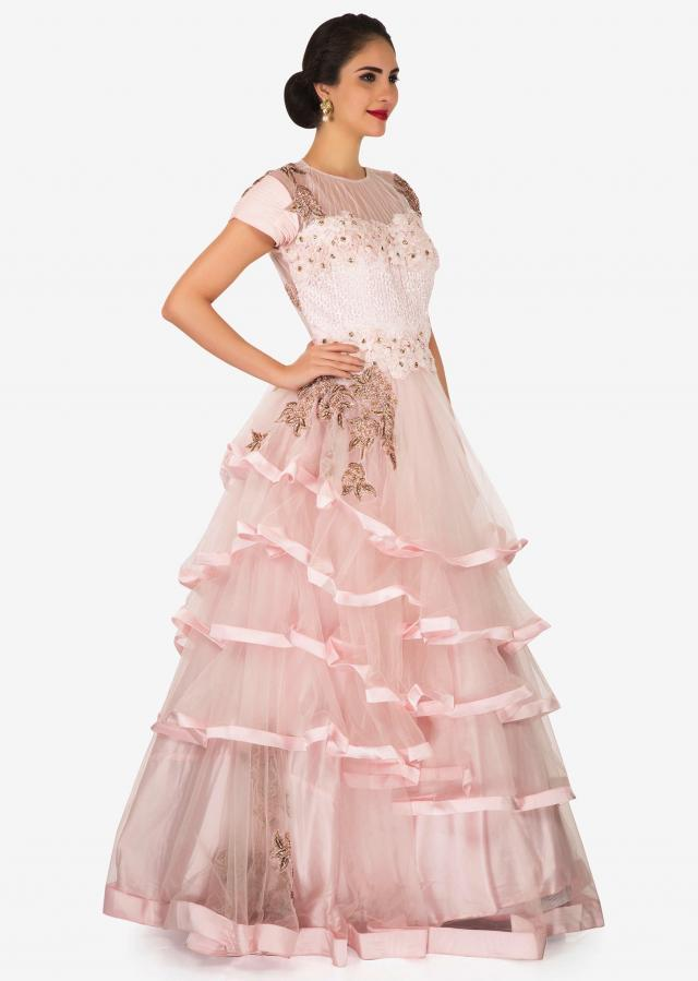 Baby Pink net gown beautified with zari cutdana work with 3D flowers only on Kalki