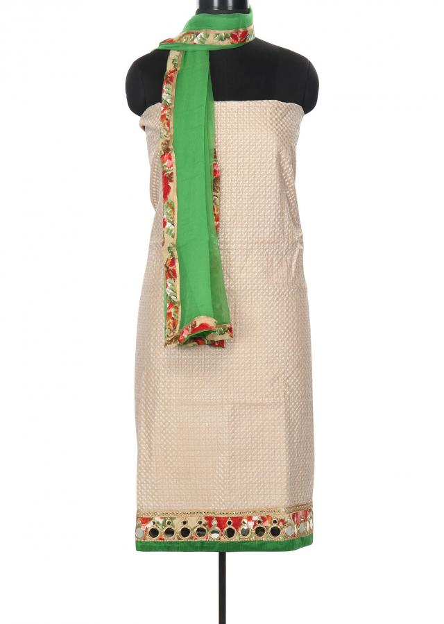 Beige and green unstitched suit enhanced in mirror border