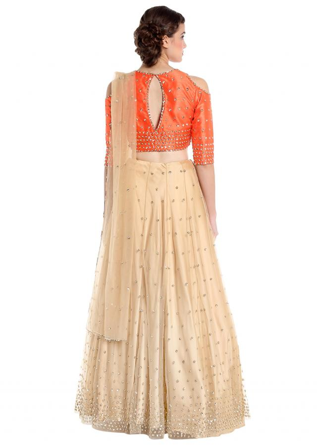 Beige and orange raw silk and net lehenga choli with sequins only on Kalki