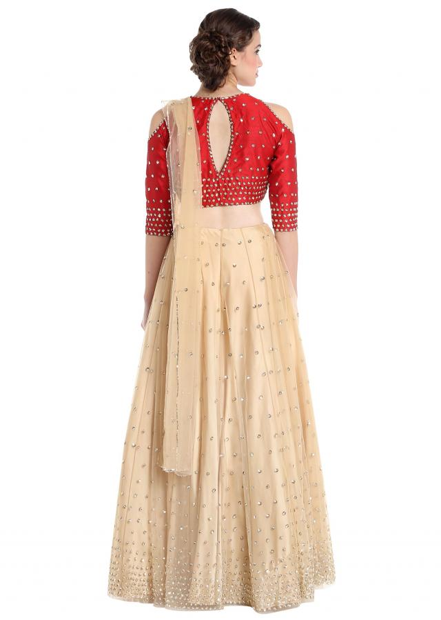 Beige and red raw silk and net lehenga choli with sequins only on Kalki