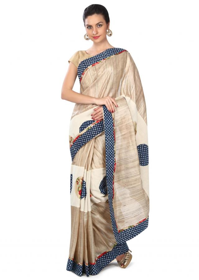 Beige saree enhanced in applique work and polk dots print only on Kalki