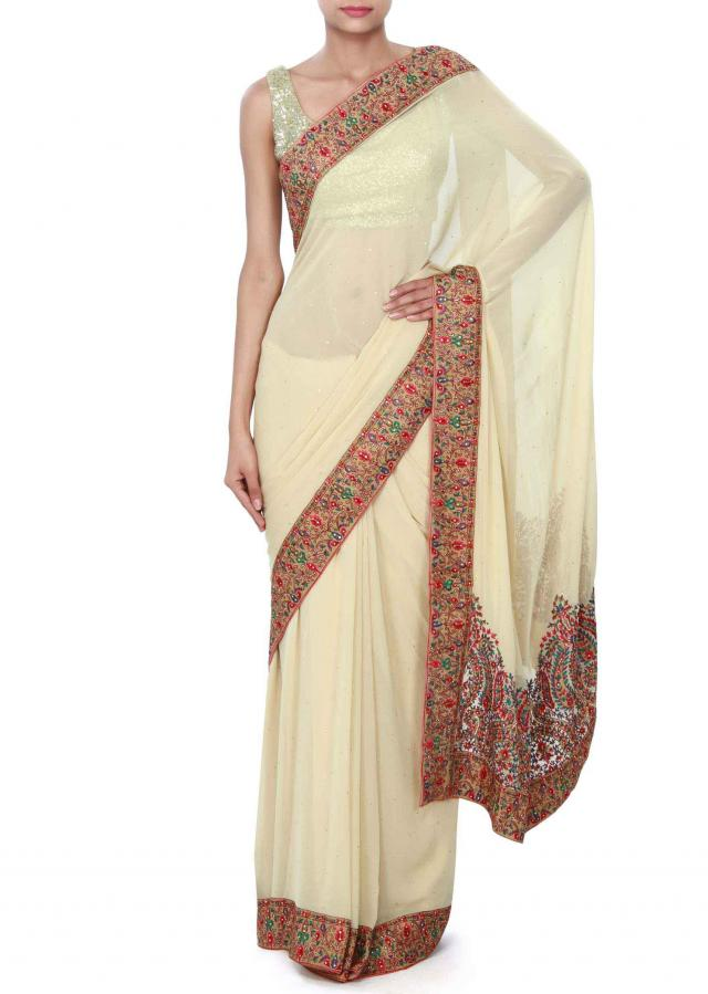 Beige saree enhanced in resham embroidered border only on Kalki
