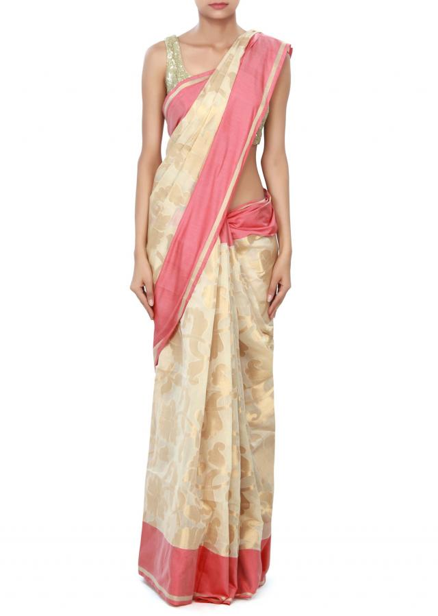 Beige saree featuring in weave embroidery only on Kalki