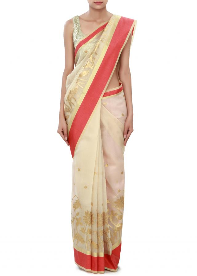 Beige saree featuring in zari weave only on Kalki
