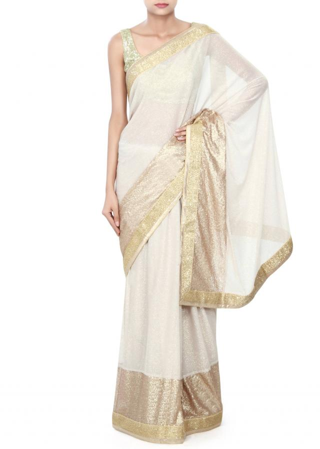 Beige shimmer saree adorn in sequin embroidery only on Kalki