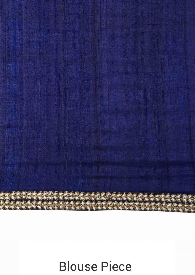 Beige tussar silk saree enhanced in embroidered border only on Kalki