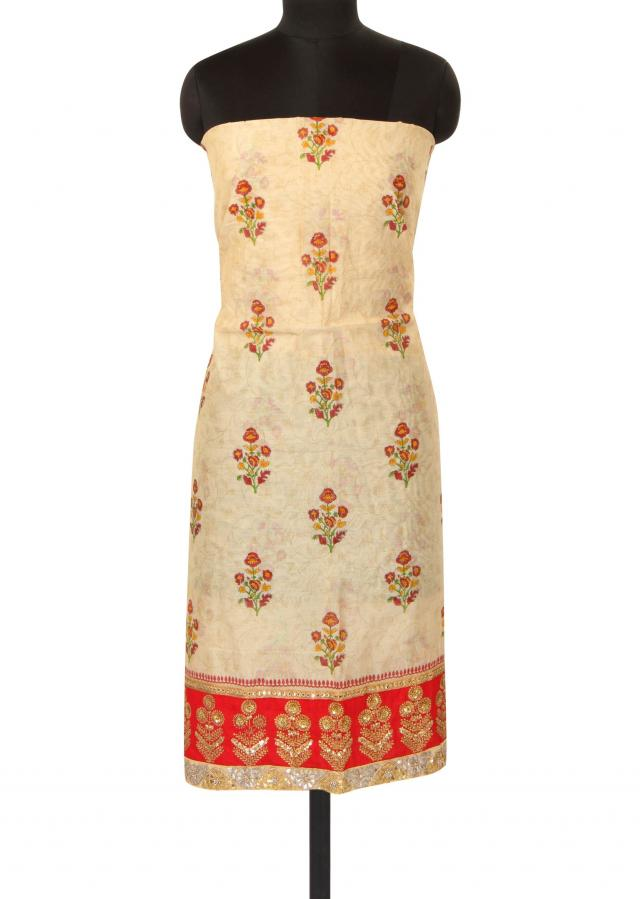 Beige unstitched suit enhanced in embroidered hem line