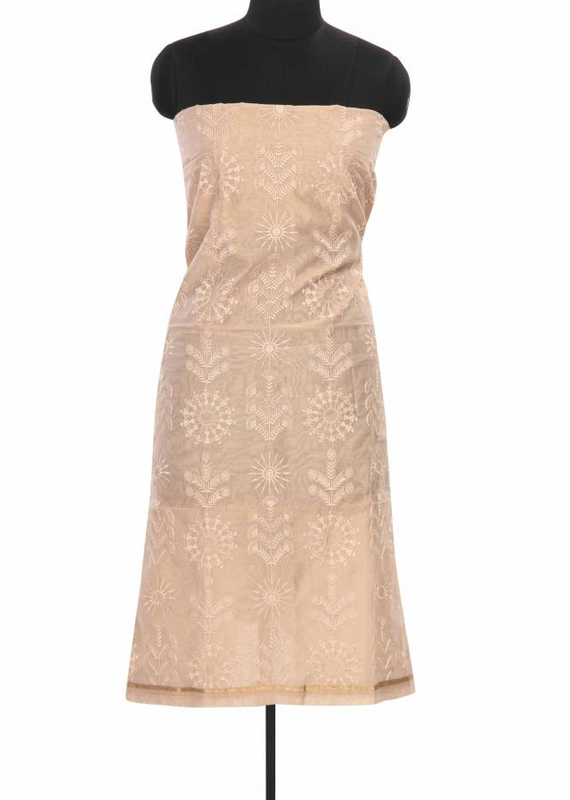 Beige unstitched suit featuring in warli motif embroidery only on Kalki