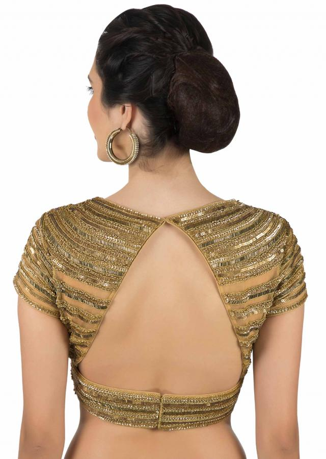 Beige blouse in net adorn in cut dana and sequin embroidery only on Kalki