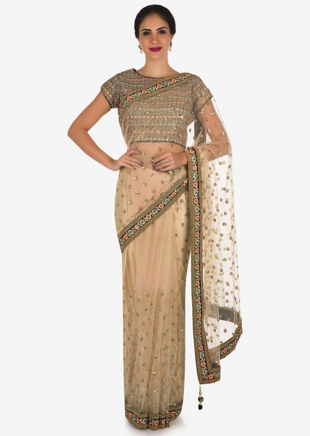 Beige saree in net with navy blue saree crafted in resham and sequin embroidery work only on Kalki
