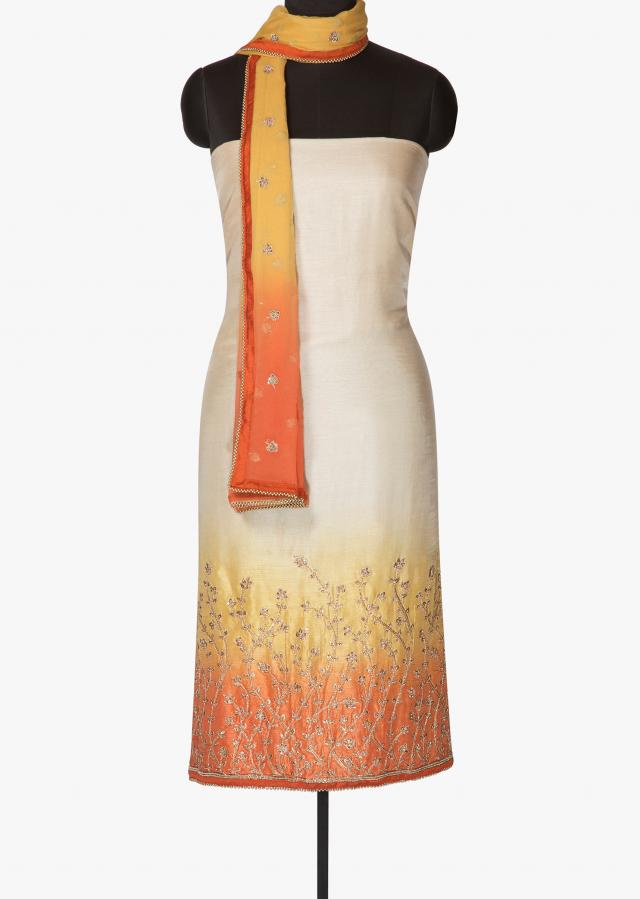 Beige,yellow and orange unstitched suit in zari only on Kalki