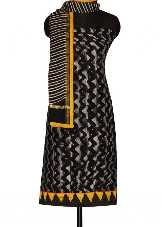 Black and Yellow unstitched suit enhanced in temple motif hem line only on Kalki