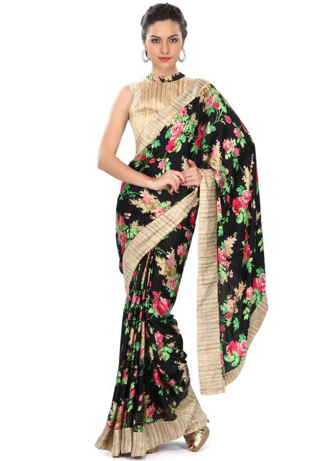 Black saree adorn in floral pinrt and silk border only on Kalki