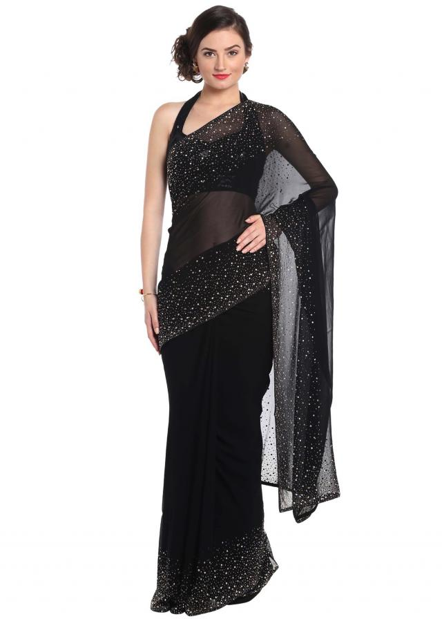 Black saree adorn in gold and silver kundan embroidery only on Kalki