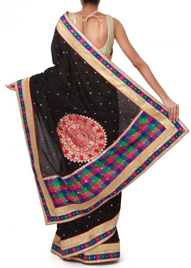 Black saree enhanced in mirror embroidery only on Kalki