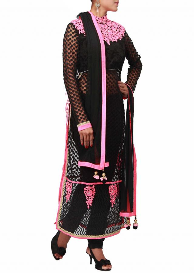 Black straight fit suit enhanced with high neck embroidery only on Kalki