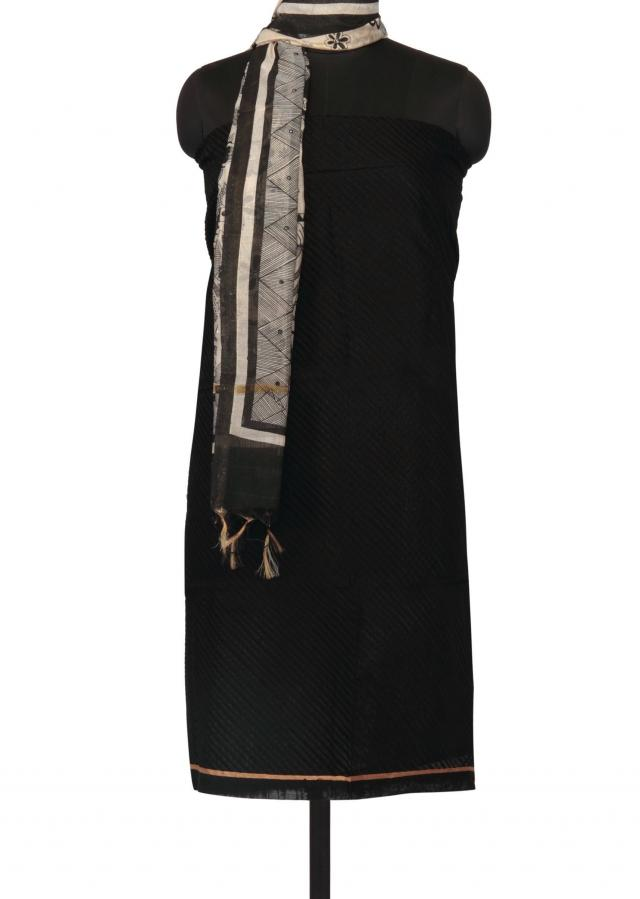 Black unstitched suit with cream printed dupatta only on Kalki