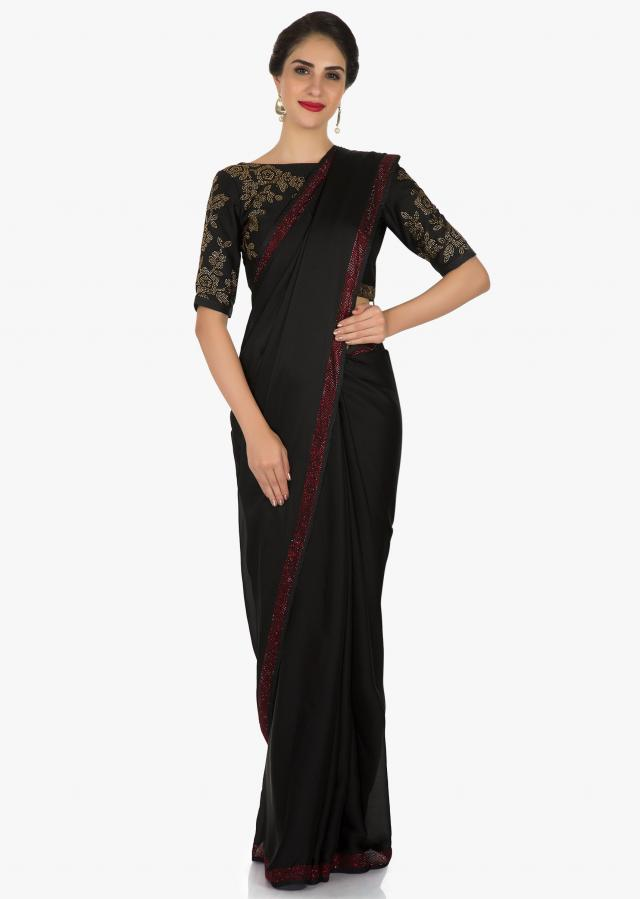 Black georgette saree adorn in kundan embroidery work only on Kalki