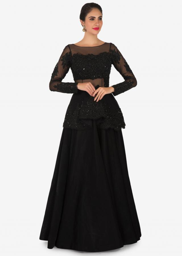Black gown in net enhanced in embroidered pleated neckline only on Kalki