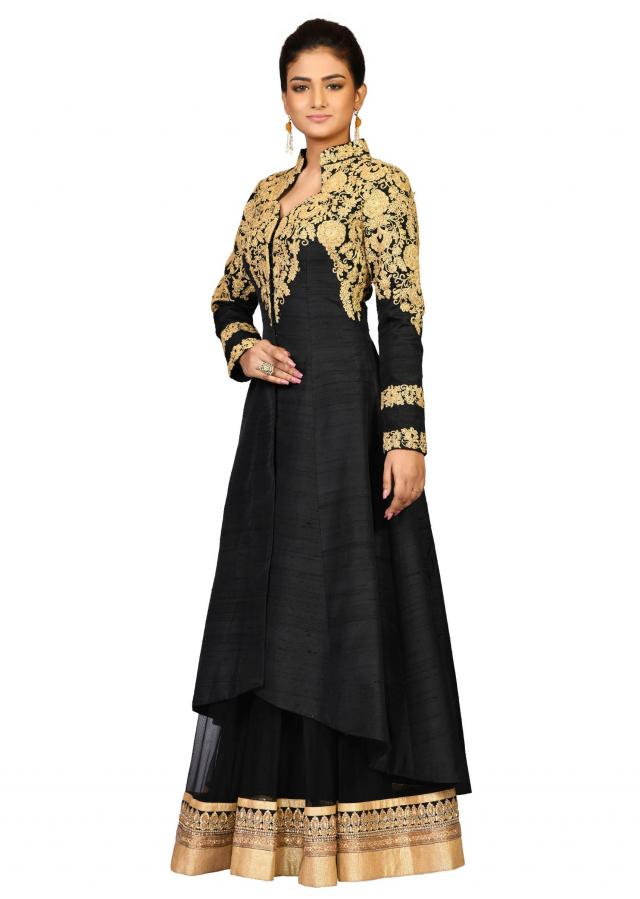 Black raw silk suit with lehenga embellished in golden dori embroidery only on Kalki