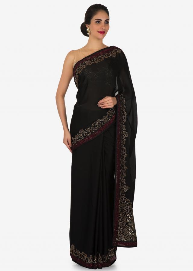 Black satin silk saree with unstitched blouse adorn in kundan embroidery work only on Kalki