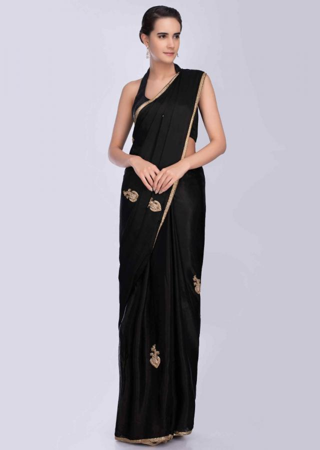 Blazzing black satin crepe saree with golden embroidered butti and border only on Kalki