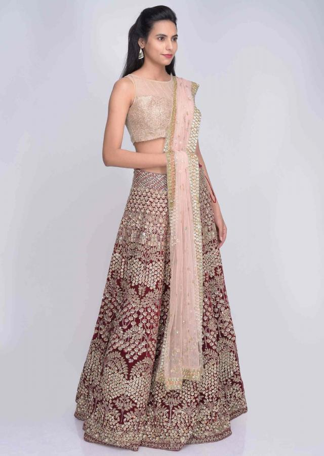Blood Red Lehenga Set In Embellished Velvet With Blush Pink Net Dupatta Online - Kalki Fashion