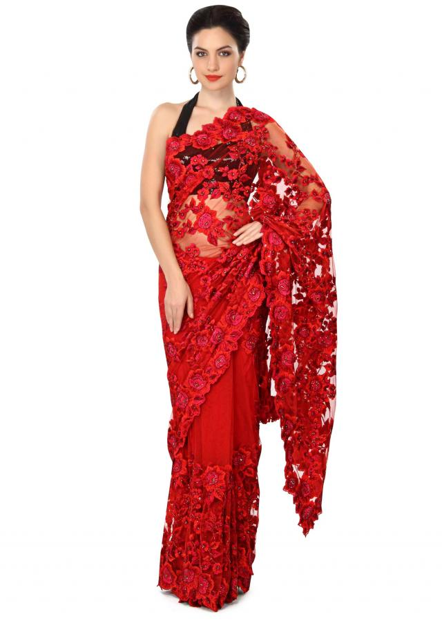 Blood red saree enhanced in resham embroidery only on Kalki