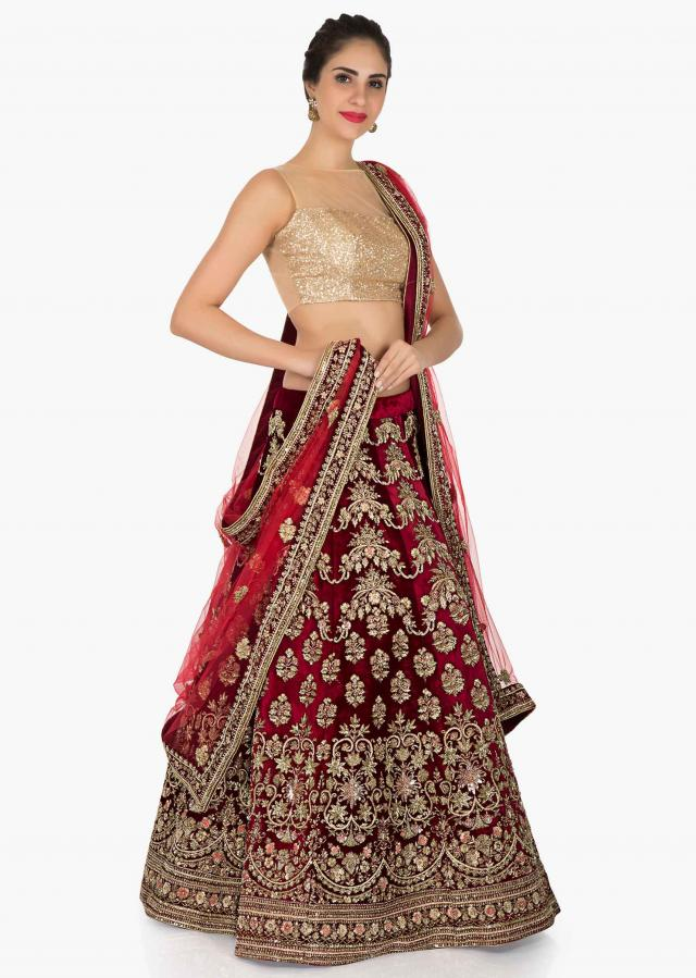 Blood red velvet lehenga beautified with heavy zardosi embroidery only on Kalki