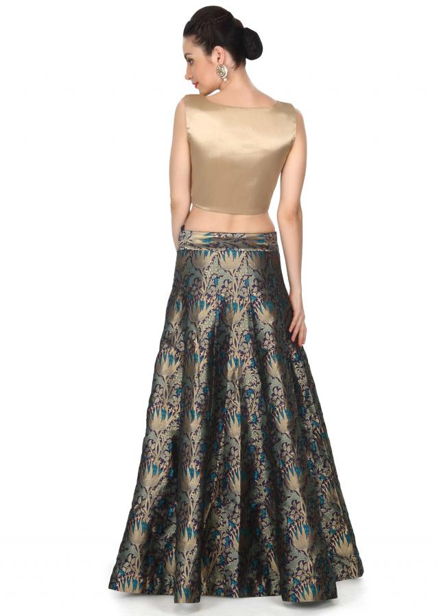 Blue skirt matched with gold crop top only on Kalki