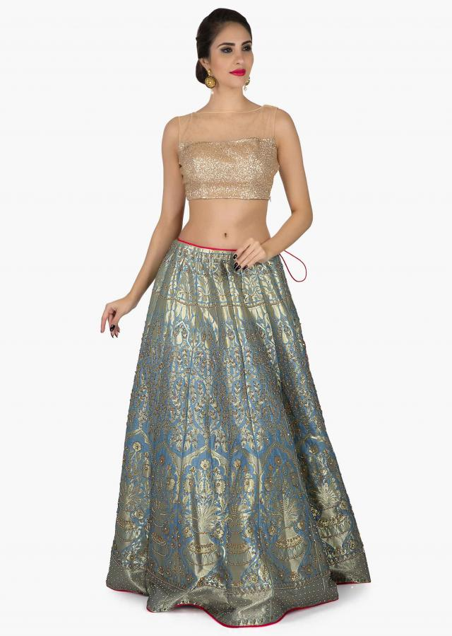 Blue Brocade Lehenga with a net dupatta only on Kalki