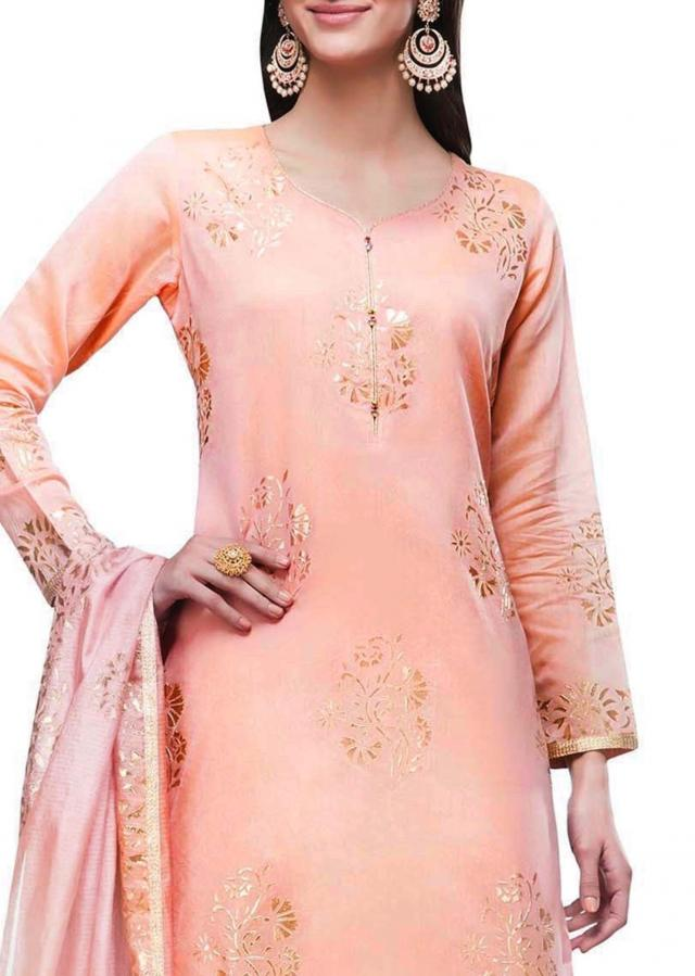 Blush pink semi stitched suit in embossed foil printed butti