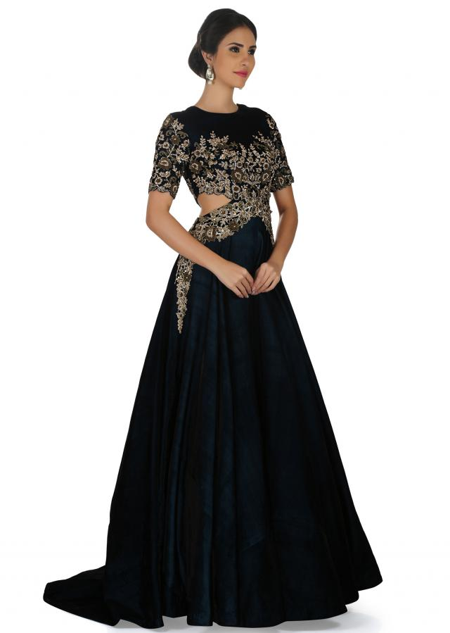 Teal blue gown in embroiderd net and pearl thread work only on Kalki