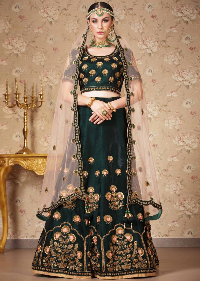 Bottle green lehenga in velvet with zardosi and sequin butti only on Kalki