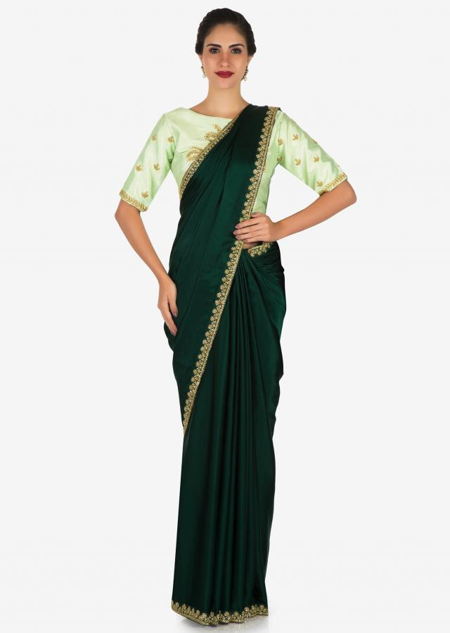Bottle green saree with mustard blouse carved in heavy cut dana embroidery work only on Kalki