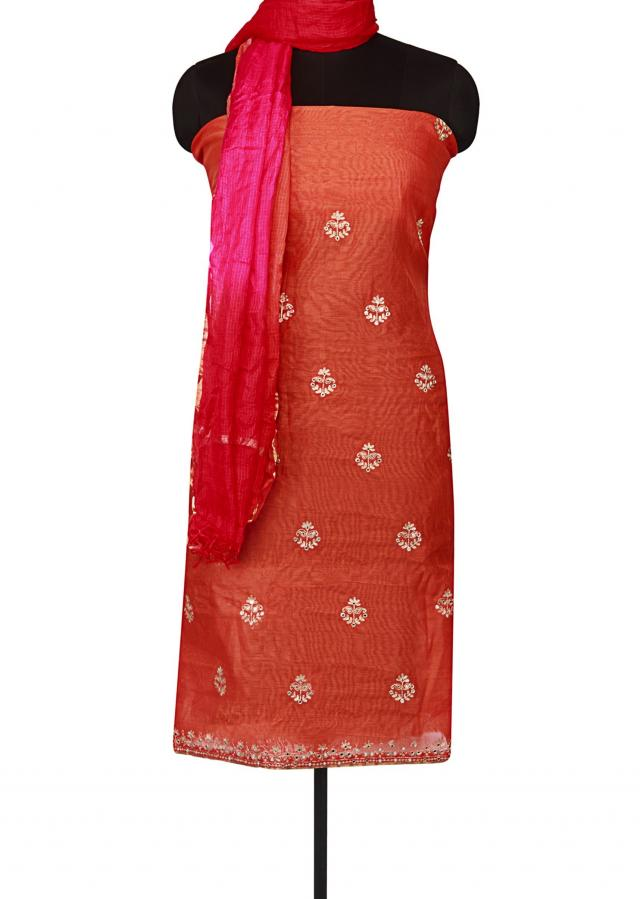 Bright orange unstitched suit with zari butti only on Kalki