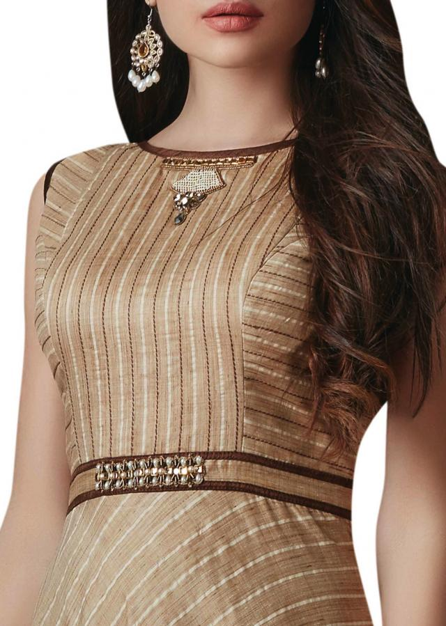 Brown anarkali suit with embroidered neckline and waist line