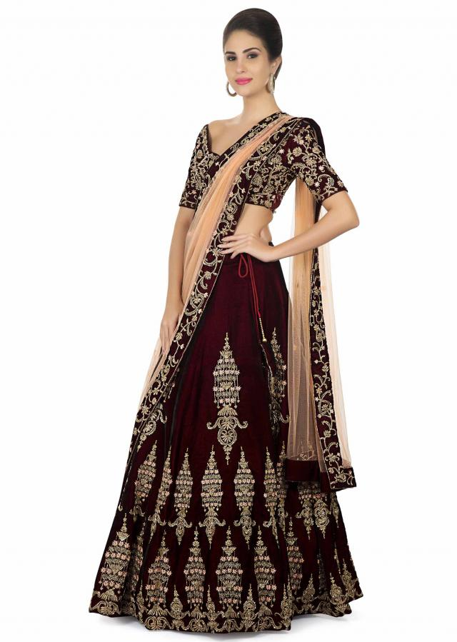 Burgundy and wine tone lehenga in embossed zardosi detailing only on Kalki