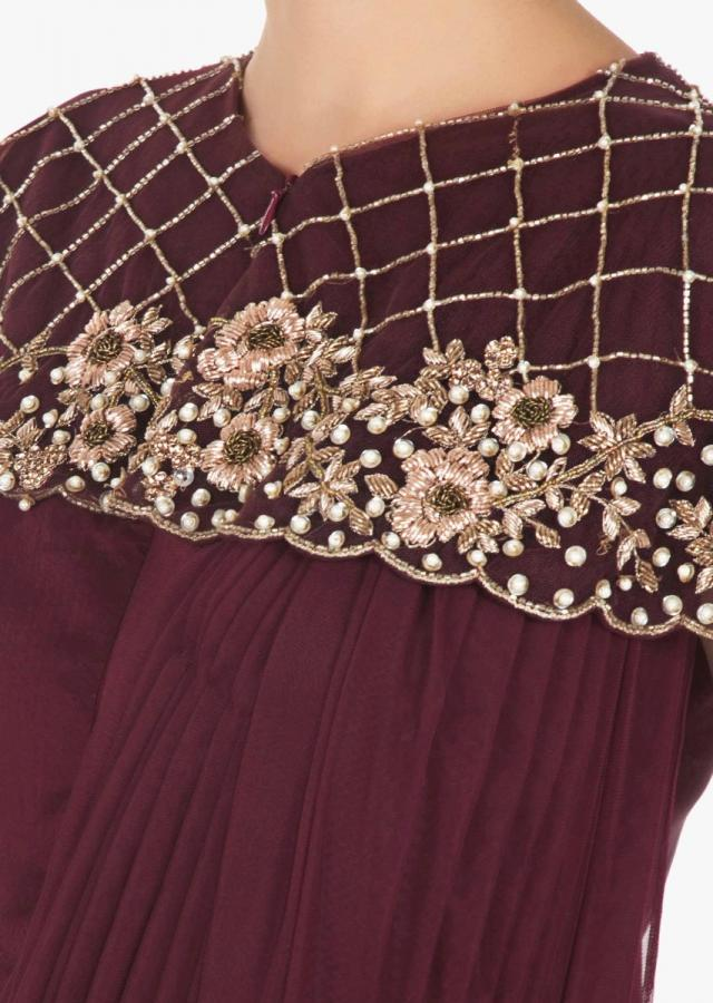 Burgundy drape gown with fancy cape embellished in zardosi and moti work only on Kalki