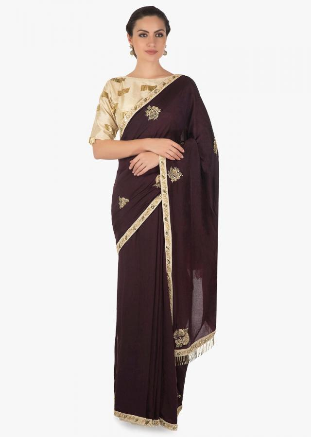 Burgundy saree with cream border in pita zari work only on Kalki