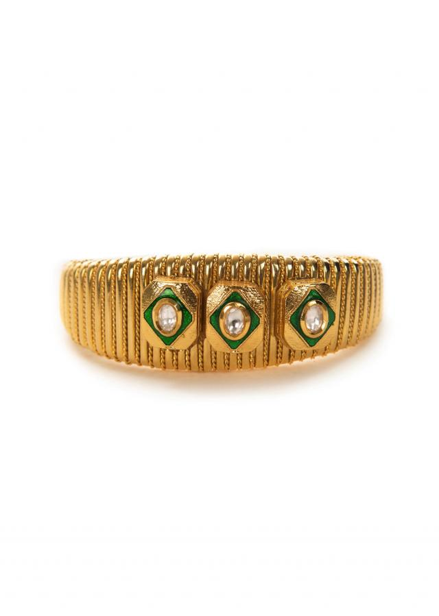 Carved golden and green bracelet only on Kalki