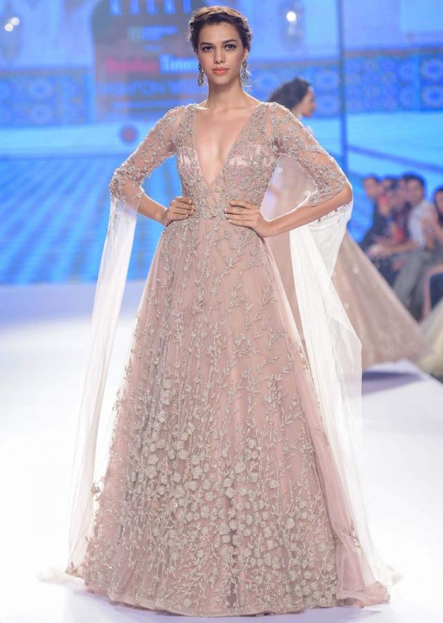 Champagne beige gown with bustier pattern bodice with trail back and sleeves only on Kalki