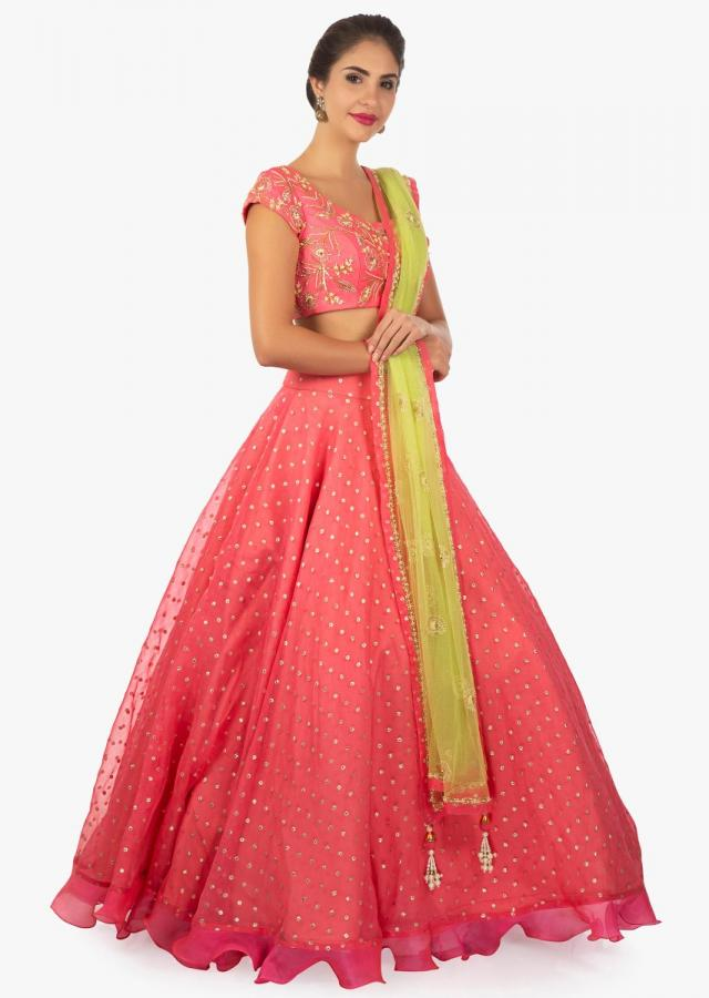 Chanderi silk pink lehenga and blouse matched with green net dupatta only on kalki