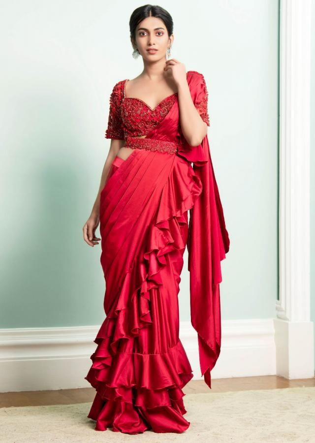 Cherry Red Saree In Satin With Stitched Ruffle Pallu Embellished Blouse And Belt Online - Kalki Fashion