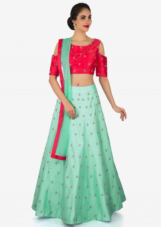 Cherry red and mint blue lehenga enhanced in cutdana and zardosi butti work only on Kalki