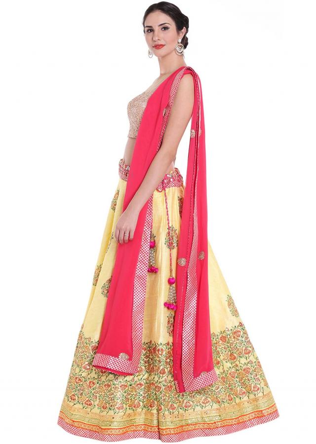 Chrome yellow lehange in resham butti with pink dupatta only on kalki