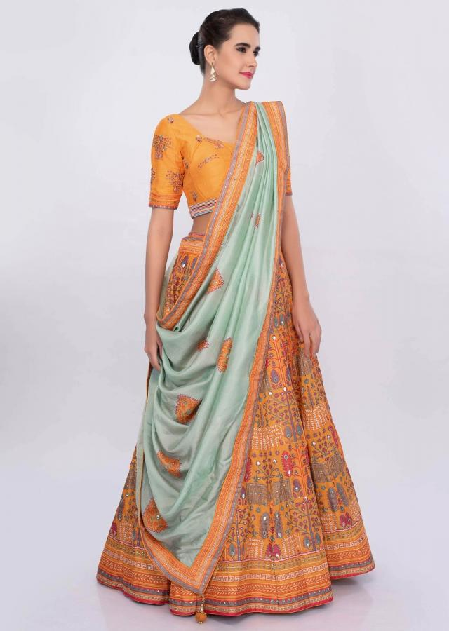 Chrome yellow  patola printed lehenga set with mint green silk dupatta  only on Kalki