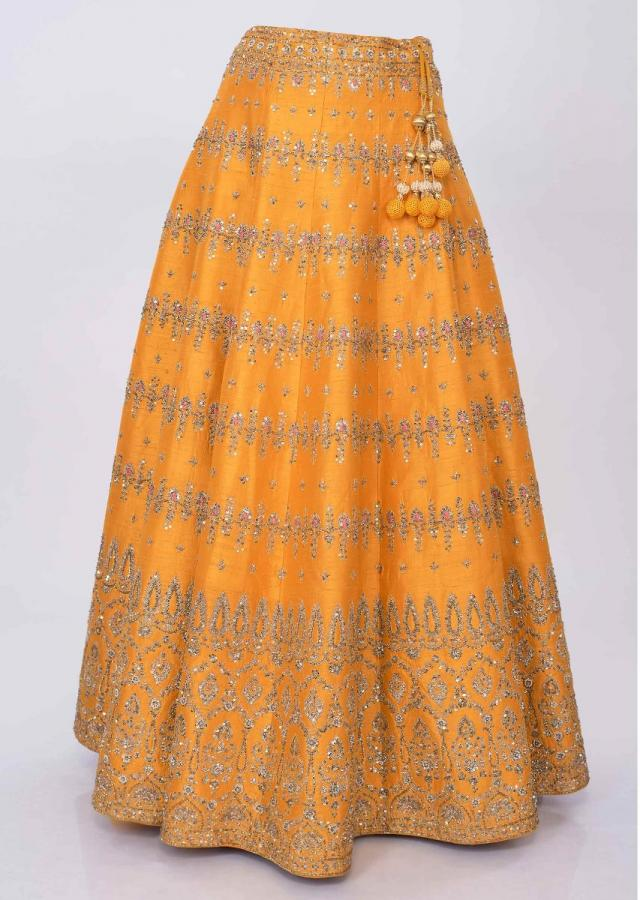 Chrome yellow raw silk lehenga with orange net dupatta only on kalki