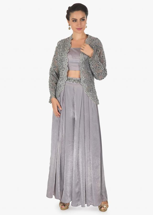 Coin grey velvet base palazzo pant matched with a simple crop top along with a net cord moti jacket only on kalki