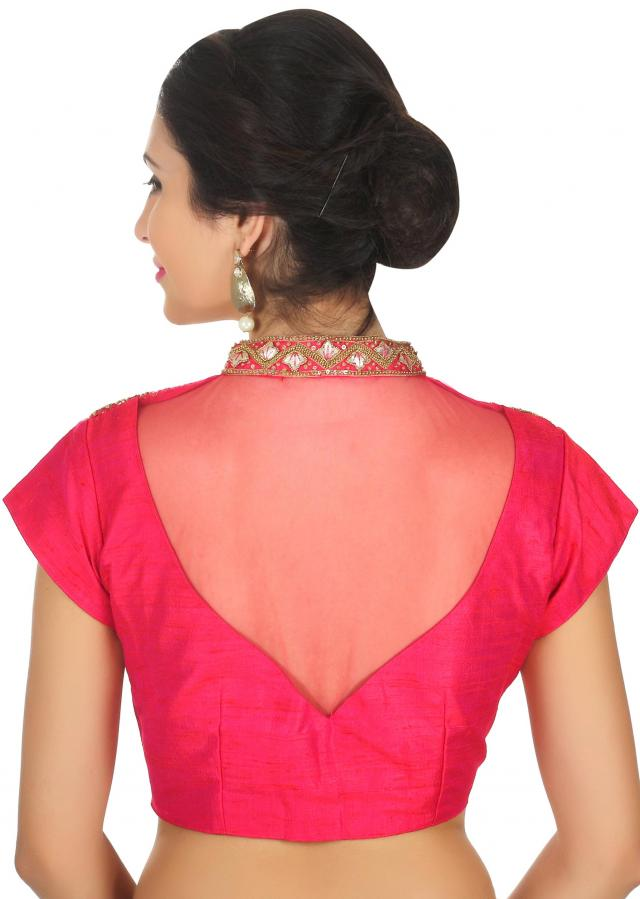 Coral blouse in raw silk with moti embroidered neckline only on Kalki